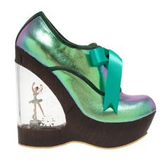 Glissade | Irregular Choice There is a winder hidden within the sole, turn it and watch her pirouette whilst beautiful music plays with every step you take! Disclaimer : We would like to advise you that the ballerina inside the heel is delicate and for decorative purposes only. She is made of metal and secured in place by screws and glue but is liable to break during heavy wear. We will not be able to repair it as it is fixed inside the heel and we will not be responsible for any breakages.