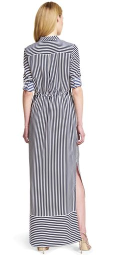 A new warm-weather staple, this striped maxi dress features a flattering cinched waist and alluring side slits.