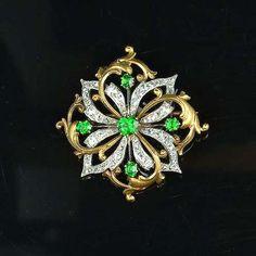 A demantoid garnet and diamond brooch