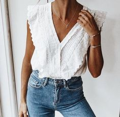 Pretty white lace blouse wit high waisted denim jeans.