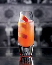 Paloma Italiana - Tequila, Campari, Pink Grapefruit Juice, Lime Juice, Lemon Juice, Agave, Orange Soda, Kosher Salt, Grapefruit Twist.