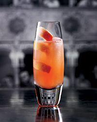 Paloma Italiana - Tequila, Campari, Pink Grapefruit Juice, Lime Juice, Lemon Juice, Agave, Orange Soda, Kosher Salt, Grapefruit Twist.