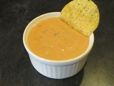 THE BEST homemade nacho cheese sauce! 2 Tbsp salted butter, 1 Tbsp flour, 1 cup milk, 1 1/4 cup shredded cheddar cheese, 1/2 cup salsa (chunky or smooth, your preference!)  Melt butter over medium heat.   Add flour and whisk until smooth. Gradually add milk, whisking after each addition. Continue whisking until milk mixture thickens, about 5 minutes. Remove from heat and stir in cheese until completely melted. Stir in salsa, and start dunking your chips!  YUM!
