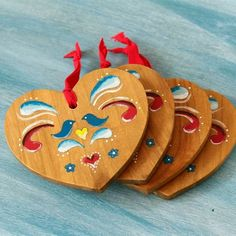 Take some plain wooden coasters and make these hanging heart ornaments - perfect for the Christmas tree.