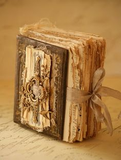 Inspiration ... charming, handcrafted  miniature book by Saimba. I love the rough page edges and the delicate ribbon closure.