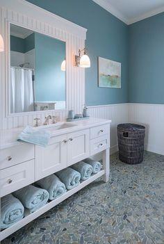 Home Interior Bathroom Blue bathroom with white vanity and pebble bathroom floor.Home Interior Bathroom Blue bathroom with white vanity and pebble bathroom floor Beach House Bathroom, Beach Bathrooms, Beach House Decor, Blue Bathrooms, Master Bathroom, Bathroom Mirrors, Bathrooms Decor, Bathroom Cabinets, Budget Bathroom