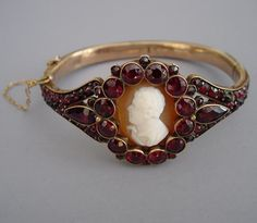VICTORIAN Bohemian garnets hinged bangle set with a portrait cameo of George Gordon, Lord Byron (English Romantic poet and personality, 1788-1824). This unusual cameo bracelet is a lovely combination of garnets and shell cameo.