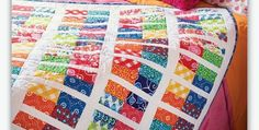 The Video Shows How to Easily Align Blocks Across the White Sashing! This colorful quilt is made from 5″ squares cut from charm packs or goodies found in your stash. The bright scrappy look is accented with white sashing. While this quilt is quite easy to make, be sure to watch the video to learn …
