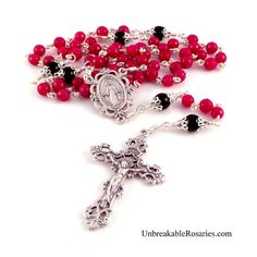 Miraculous Medal rosary beads in faceted red jade and black onyx. www.UnbreakableRosaries.com