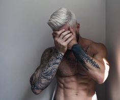 Hunk with Tattoos and Platinum Hair
