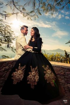 Pre Wedding - Bride in a Black Gown with Golden Embroidery and the Groom in a White Coat | WedMeGood #wedmegood #indianbride #indianwedding #bridal #indiangown #blackgown #gown