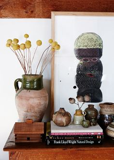 Brendan Huntley painting. Books from Artisan Books, Ceramics Sarah has collected from all over. Billy Buttons in vase from Mr Lincoln. Photo - Sean Fennessy, production – Lucy Feagins / The Design Files.