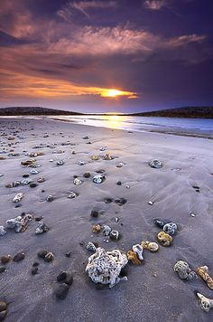 A beautiful sunset in bali + interesting stones on the sand