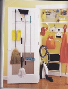 broom closet.  Uses back of door. Vacuum hose hangs up with 3M hook.  REPLACE SLIDING DOORS IN KITCHEN CLOSET