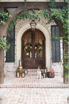 Front door ideas and design to add curb appeal for new house, renovation, new build, or remodel: brick front porch with arched wood stain french front doors Home Fashion, Exterior Design, Colonial Exterior, Colonial Front Door, French Country Exterior, Exterior Paint, Door Design, House Colors, My Dream Home