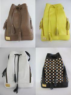 Lembra-se das bucket bags ou bolsas saco? Elas voltaram com tudo na semana de moda de Milão. Confira os modelos arrojados, coloridos e versáteis do inverno 2015.