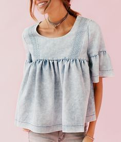 Looking for a unique vibe this spring? Stand out from the crowd in our Bohme Field of Bluebells denim babydoll top! We love the light wash, bell sleeve, and lace detailing!