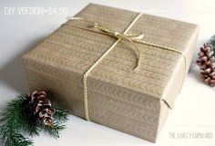 Using brown kraft paper and a gold paint pen, recreate a wrapping paper from Anthropologie.