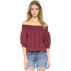 Apiece Apart Margarita Off Shoulder Top ($280) ❤ liked on Polyvore featuring tops, cranberry, crop top, pom pom shirts, smock tops, smocked top and crop shirts