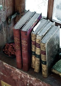 old books on the window sill