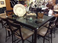Counter Height Table & Chairs - Counter height table and 8 chairs.   Extremely well made with metal frames for the table and chairs.   Glass top  54 inches by 54 inches.   Excellent condition with no signs of wear. Item. 481-1.  Price $1850.00    - http://takeitorleaveit.co/2014/07/05/counter-height-table-chairs/