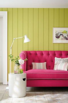 Aside from the fact we're always partial to some wall cladding and we've completely fallen for this button-back sofa, the colour combination of a lime green and hot pink is one that will bring a perenially positive vibe to your living room.