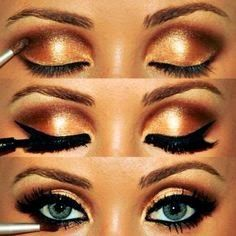 Gold makeup for blue eyes creates a glowing summer look! For products that will make your blue eyes pop, visit Beauty.com.
