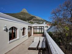 Designer lock up and go with grand accommodation. Open plan lounge, dining room and family room flowing to pool. Separate study. Cookbook kitchen. 4 Bedrooms main luxuriously en suite. Enormous roof deck with Jacuzzi and sublime sea and mountain views. 3 Car garaging and staff quarters. Elevator access to all levels. A must to view. Lions Head Cape Town, Roof Deck, Elevator, Mountain View, Jacuzzi, Open Plan, Separate, Family Room, Bedrooms