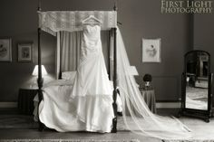 One of our four-poster beds. Complete with a very elegant wedding dress.