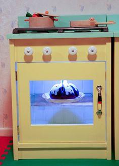 use a cooling rack! looks like a real oven rack. [LED lights inside, push light]