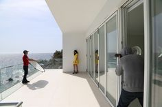 Behind the scenes of Vogue Photoshoot with Vera Filatova in Foros Yacht House by www.robinmonotti.com on the left: Hair and Make up Artist Theo Dekan on the right: Photographer Sergei Iliin Vera's wearing Yellow dress and Black sandals both by Alexander Mc Queen