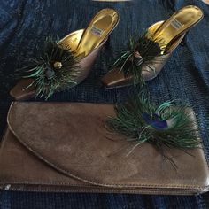 Bronze Peacock Clutch and heels SZ 6.5 For the fashion lover! Great clutch and heel set. Perfect with a simple dress or pant suit. Makes the outfit. Both in good condition. Timothy Hitsman Shoes Heels