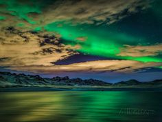 You're probably getting sicj if /aurora borealis, but they're just so pretty!  Cloudy Evening with Aurora Borealis or Northern Lights, Kleifarvatn, Iceland Photographic Print by Green Light Collection at AllPosters.com