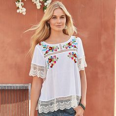 """FAIRYTALE BLOSSOMS TOP--Sweet posies of embroidered flowers, airy, inset lace and dramatic, deep lace hems add feminine charm to our flowing, cotton top. Hand wash. Imported. Exclusive. Sizes XS (2), S (4 to 6), M (8 to 10), L (12 to 14), XL (16). Approx. 24-1/2""""L."""