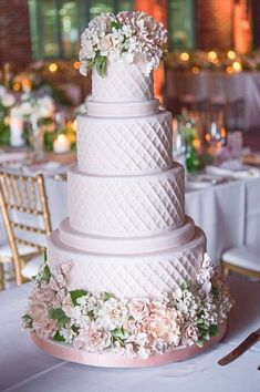 This four-tier blush beauty adorned with sugar flowers is almost too pretty to eat! Photo Credit: Amsis Photography   Cake: @BobbetteBelle #weddingcakes