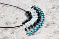 This stunning, one of a kind, safety pin necklace is a unique piece of fashionable jewelry. This necklace is made out of glass seed beads and steel nickel plated safety pins. It is a perfect accent to any outfit.  Earrings to match can be made upon request.