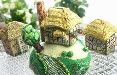 Tiny cross-stitch pin cushion hill and cottage