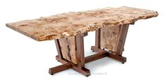 Our Nakashima Style Dining Table pays tribute to George Nakashima's unique style of furniture. Mr. Nakashima was a pioneer and incredible designer.  This unique table features an asymmetrical, live edge burl wood slab top. This burl wood is some of the most unique wood found anywhere on earth. The burl slab shown in this