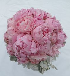It doesn't have to be pink, but I love this peony arrangement!!  Pink Peonie wedding bouquet