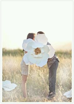 Engagement Shoot Inspiration: 15 Couple Poses You've Just Got To Try! flowers couple Engagement Shoot Inspiration: 15 Couple Poses You've Just Got To Try! Engagement Props, Engagement Couple, Engagement Pictures, Wedding Engagement, Giant Paper Flowers, Diy Flowers, Flower Colors, Flower Paper, Large Flowers