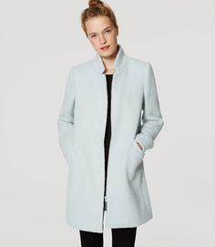Soft blue coat.