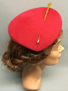 This felt fascinator, The Jasmine, has a slanted crown and its quirky shape projects a subtle sense of individuality. Attached with elastic and trimmed with a beautiful vintage hat pin. Colour: Red #Fabhatrix #Edinburgh #Grassmarket #felt #fascinator #occasion
