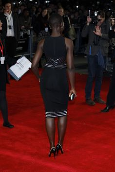 Lupita Nyong'o in Christopher Kane dress and Christian Louboutin shoes.