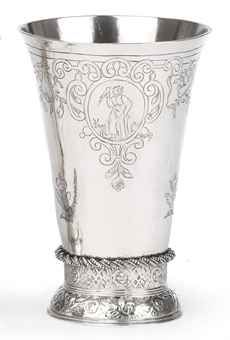 A Dutch silver beaker  Groningen, 1651/52, possibly the mark of Adriaan Muntinck  The flared body on a cast and domed foot decorated with foliage and cherubs below a band of trelliswork and flowerheads, with a spiral twist band, the lower part of the body engraved with three flowers, the upper part with three oval cartouches with figures emblematic of Faith, Hope and Charity with festoons of fruit in between, marked on base  13.5 cm. high  146 gr.