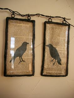 old rusty frames, a piece of barbed wire for the hanger, grunged book pages and crow cutouts...so prim