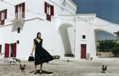Irina Shayk models fit and flare dress from Miu Miu