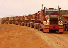 Road Train ( imagine the horse power in that's in that gargantuan truck ? ) The truck driver uncoupled the 'carriages' and his only speed limit on a track at the weekend off time, is how much pressure the tyres can take ‼️✅ Big Rig Trucks, Dump Trucks, Cool Trucks, Peterbilt, Kenworth Trucks, Train Truck, Road Train, Cool Pictures, Cool Photos