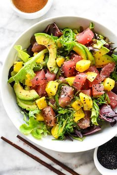 A simple three ingredient dressing tops fresh ahi tuna, mango and avocado on a bed of spring mix.