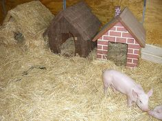 The Three Little Pigs Houses for the pet oinkers. If we ever get pigs, we are totally doing this!
