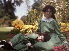 Iris and Janet sit in the garden of their family home, Bury Knowle, in Headington, Oxford. Laing, a gifted amateur photographer and artist, photographed her daughters many times in and around their home. The autochrome process (patented by the Lumière brothers in 1903) continued to be the most popular colour photographic process until the early 1930s.